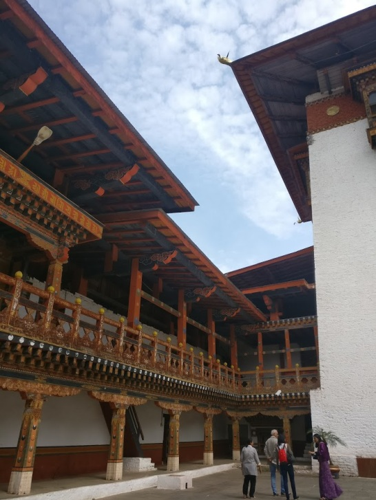 The traditional painted wood work of the roofs and the fenestrations of the Punakha Dzong